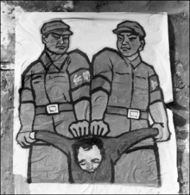 "This poster, displayed in late 1966 in Beijing, shows how to deal with a so-called ""enemy of the people"" during the Cultural Revolution. (Jean Vincent/AFP/Getty Images)"