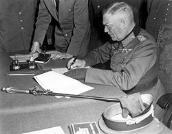 Field-Marshal Keitel signing the ratified surrender terms for the German military